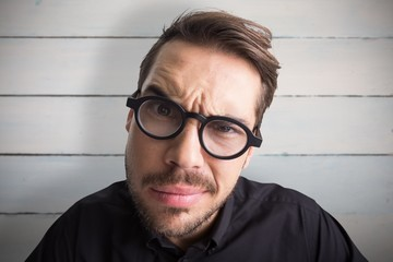 Doubtful businessman with glasses