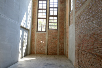 Sunlight from window on the cement walls and floor