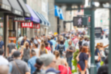 Crowded sidewalk on 5th Avenue with tourists. Blurred Background