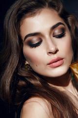Beautiful sexy woman golden makeup brunett pink lips