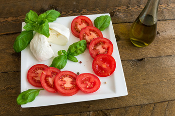 Caprese salad with tomatoes and mozzarella on the plate
