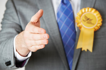 Close Up Of Liberal Democrat Politician Reaching Out To Shake Ha