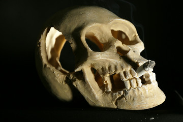 Smoking human scull with cigarette in his mouth