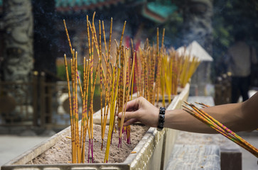 Incense sticks burning at a Taoist temple, Hong Kong.