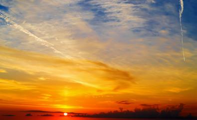 Fotobehang - orange, yellow and blue scenic sky at dusk