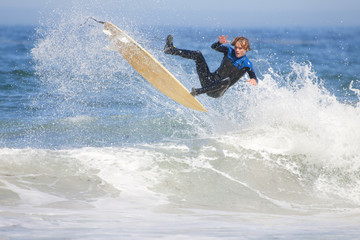 Surfer, mid air, falling off surfboard
