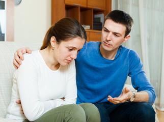 Sad woman, man consoling her