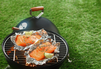 Gourmet barbecue with grilled salmon fillets