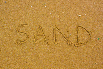 Sand handwritten on the beach