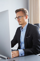 Handsome business man working with computer.