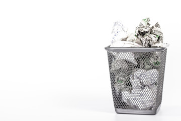 isolated wastebasket full of white waste newspaper
