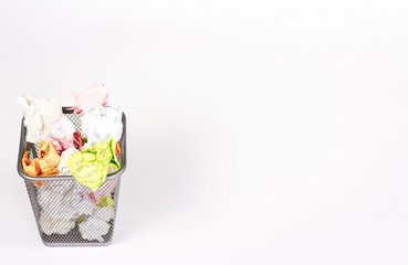isolated wastebasket full of color waste paper