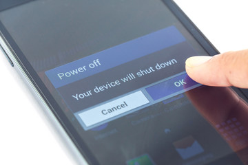 finger press power off button on smartphone