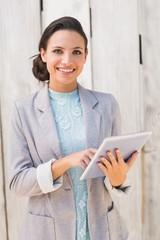 Stylish brunette using tablet pc