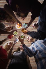 Composite image of friends toasting