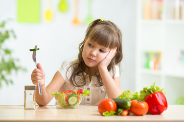 Child looks with disgust for food.