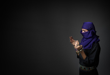 islamic woman praying with open hands