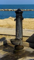 Characteristic old fountain of the promenade of Bari. Apulia