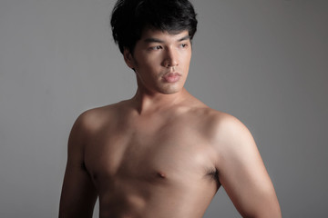 Portrait of Handsome Asian male model in Shirtless