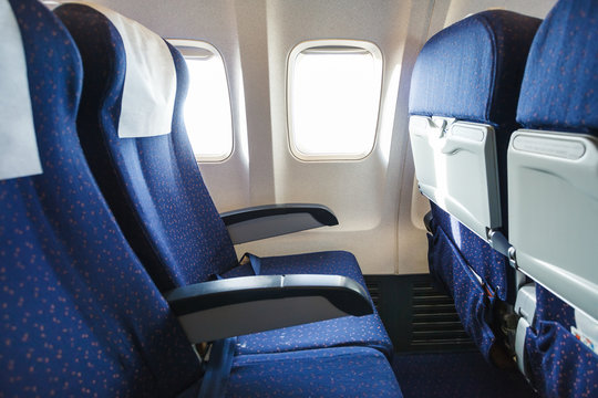 textile seats in economy class section of airplane