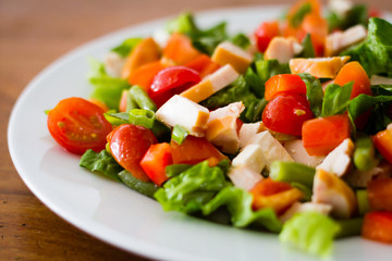 Healthy looking salad on a white plate