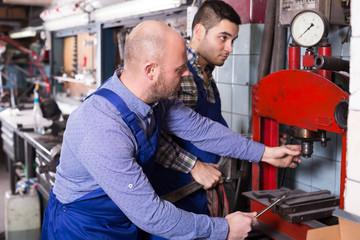 Mechanics working at workshop