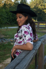 Woman in cowboy hat, smiling at the camera
