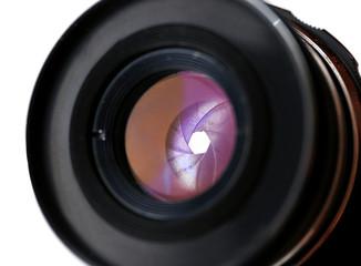 Camera lens on light background