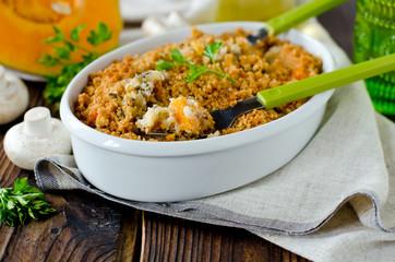 Casserole of rice, squash and mushrooms