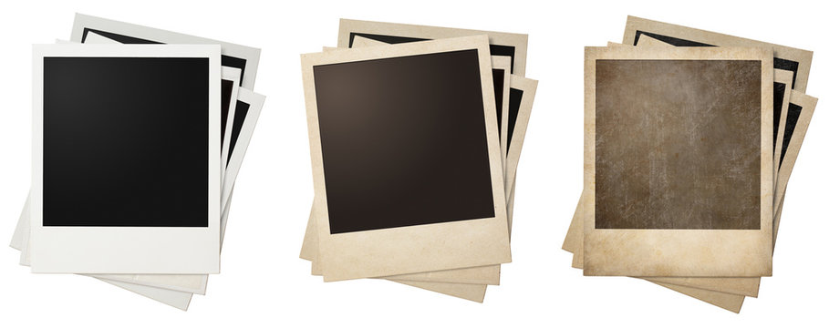 old and new polaroid photo frames stacks isolated
