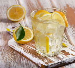 Glass of fresh water with  lemon.