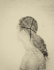 double exposure photo of young woman and tree log texture, retro