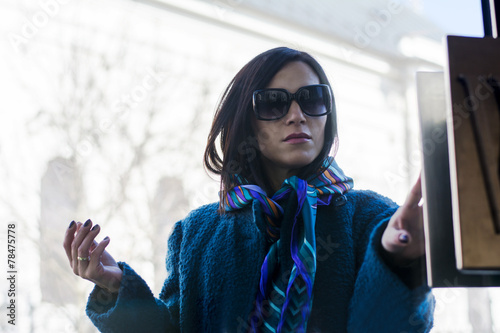 Woman Walking Into A Store Through Glass Door Stock Photo And