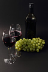 wine glasses and bottle with grapes