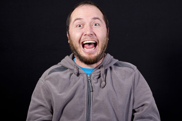 man laughing out loud isolated on white background