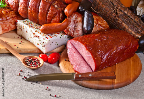 Fototapete smoked meat and sausages