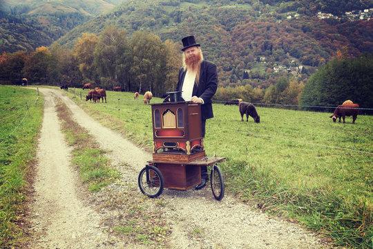 Man playing his cart organ around, portrait