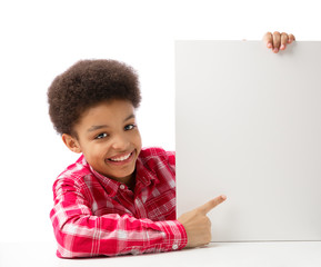 African American school boy pointing at white blank