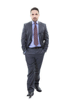 Friendly and smiling businessman looking at camera with