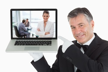 Smiling marketing manager standing in conference room