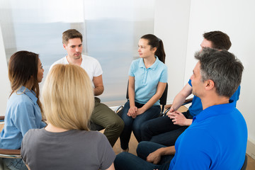 Group Of People Having Discussion