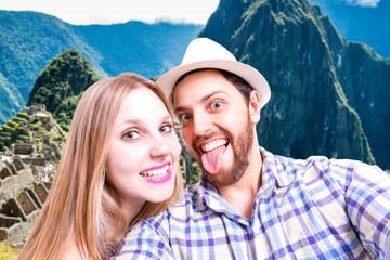 Beautiful Couple taking a selfie photo in Machu Picchu, Peru