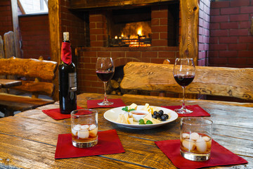 Romantic dinner for two near fireplace