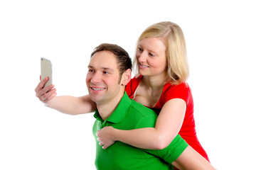 young couple in an embrace take selfie