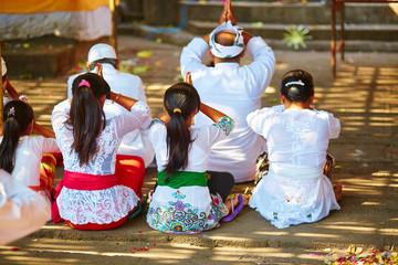 Balinese women praying in a temple