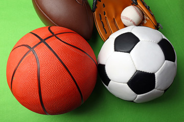 Sports balls on green background