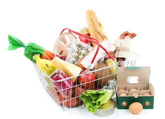 Metal shopping basket with groceries isolated on white