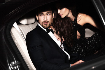 Canvas Prints People Sexy couple in the car. Hollywood stars.