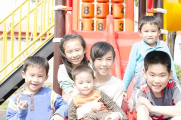 children play in the amusement park
