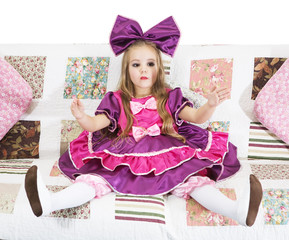 beautiful little girl dressed as doll. living doll